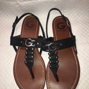 G by Guess black thong sandals.